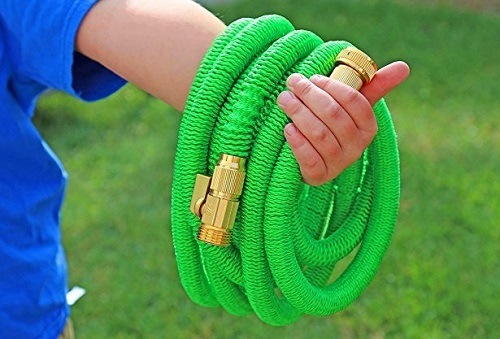 Green Expandable Hose In Hand